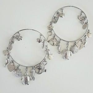 Silver hoop earrings by Noir